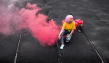 Trendy Teen Hipster Sitting Near Smoke Bomb