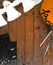 Top View Of Halloween Decorations On A Wooden Table