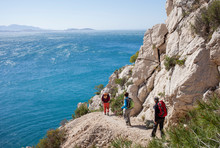 Hikers On The Edge Of Mediterr...