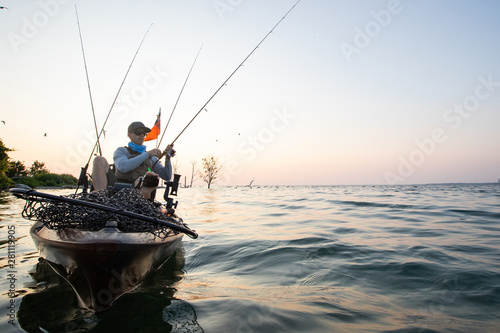 Poster Peche Young Man Kayak Fishing at Sunrise in Canada