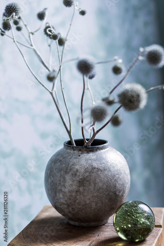 Fototapeta Close up of boho style vase with flowers obraz