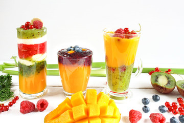 Multilayered smoothie with yellow, green and red fruits and vegetables