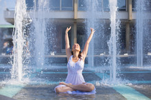 Young Woman Cooling Down In Fo...
