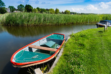 Small Boats In Canal. Broek Op Langedijk, The Netherlands
