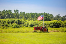 Symbols Of American Farming: Tractor And Flag