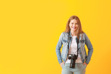 Young Female Photographer On C...