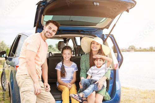 Vászonkép Happy family near car outdoors
