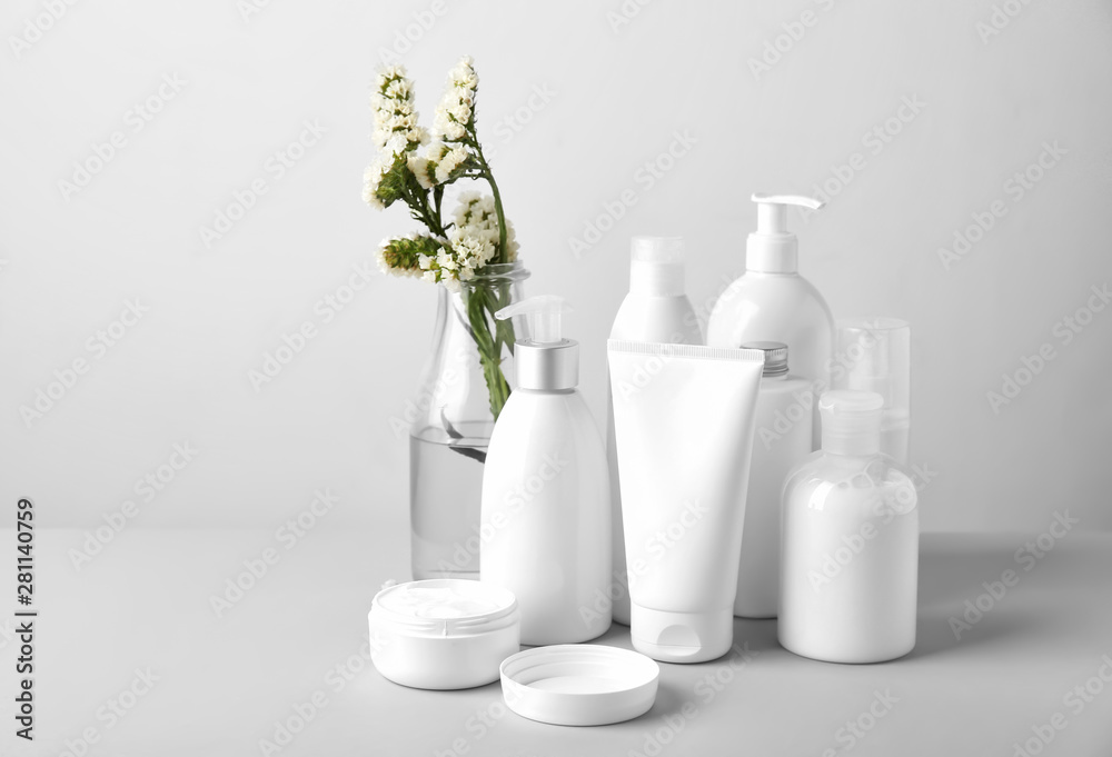 Fototapeta Set of cosmetic products on light background