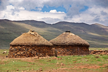 Traditional style of housing in Lesotho is called a rondavel. The roof itself is made out of thatch that is sewn to the wooden braces with rope