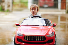 Small Girl Driving Toy Car