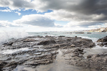 Breaking Waves On A Stony Beach