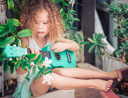 Portrait of a cute girl with ukulele - 281170902