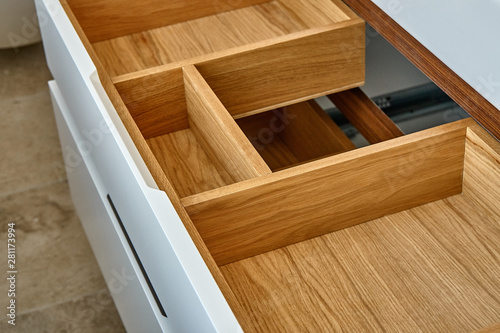 Obraz na płótnie Opened wooden drawer of bathroom vanity in luxury bathroom