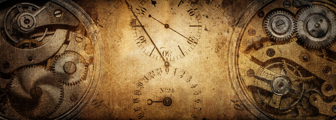 The dials of the old antique classic clocks on a vintage paper background. Co...