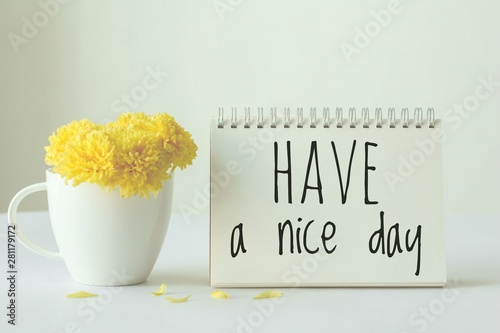 Have a nice day note on paper with yellow in white cup of coffee on white background Canvas Print