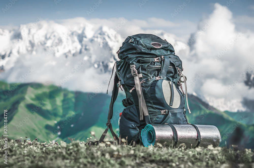 Fototapety, obrazy: Tourist backpack and sleeping pad on a background of mountains