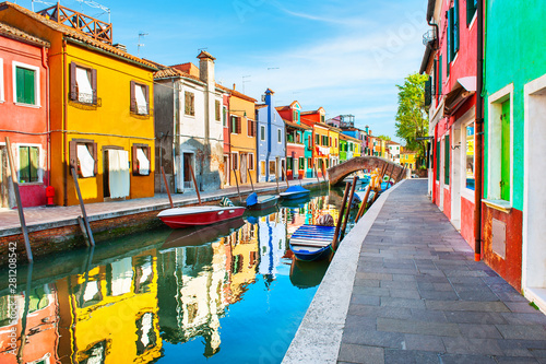 Slika na platnu Colorful houses with reflections on the canal in Burano island, Venice, Italy