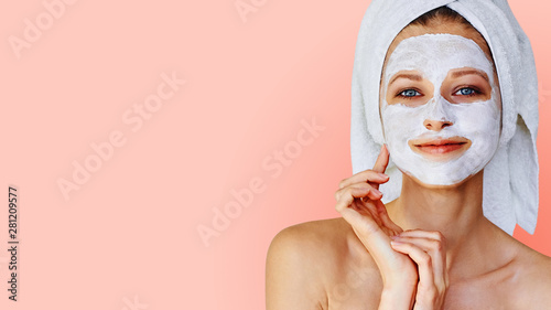 Acrylic Prints Spa Beautiful young woman with facial mask on her face. Skin care and treatment, spa, natural beauty and cosmetology concept.
