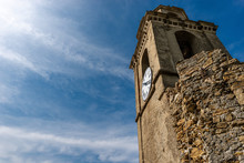 Old Bell Tower With Clock On Blue Sky With Clouds. Church Of St. Francis, Vernazza Village. Cinque Terre, Liguria, La Spezia Province, Italy, Europe. UNESCO World Heritage Site