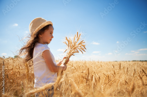 Happy girl walking in golden wheat, enjoying the life in the field Canvas Print