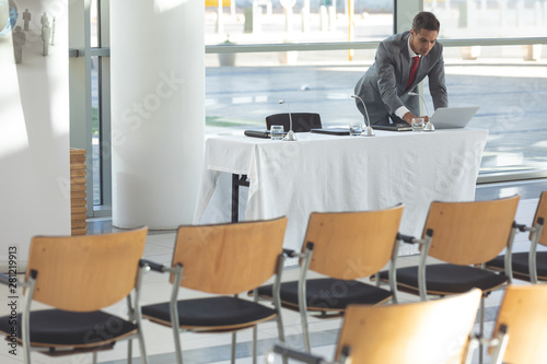 Businessman watching his computer in conference room