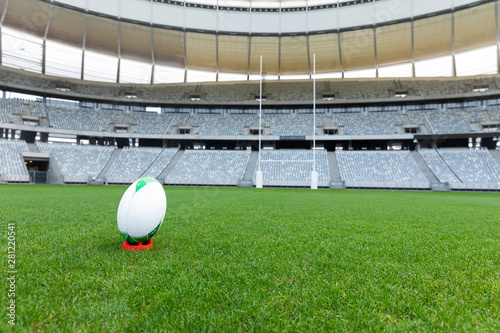 Rugby ball on a stand in a stadium