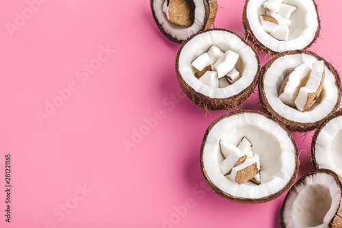 Poster Pays d Europe Broken coconut pieces on bright pink background, top view, copy space