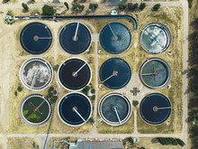 Wastewater And Sewage Treatment Plant, Aerial Top View From Drone