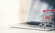 Shopping Cart With Laptop On T...