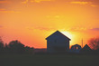 Rural landscape in the evening at sunset. Silhouette of a village against the beautiful evening sky