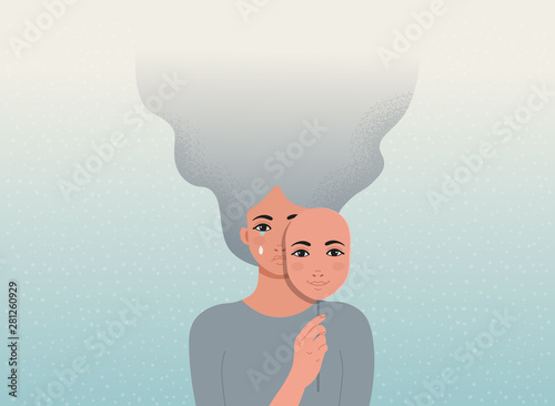 Obraz Sad woman is covering her face with a smiling mask. Concept good and bad mood. - fototapety do salonu