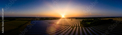 Tuinposter Zonsondergang Solar farm panoramic at sunrise