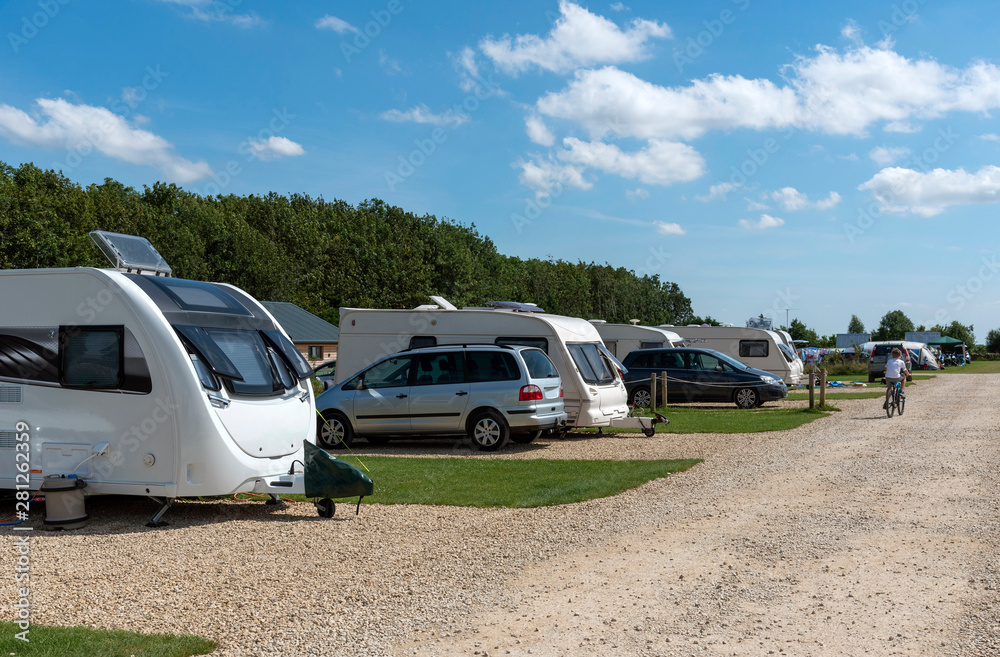 Fototapety, obrazy: Cheltenham, Gloucetsershire, England, UK. July 2019.  A caravan park in the Cotswolds region of Gloucestershire.
