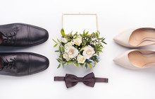 Wedding Shoes And Bouquet On W...