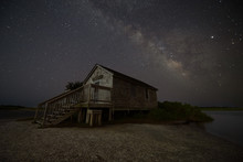 Milky Way Over A Shack In Assateague Island