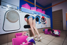 Young American Woman Washing Her Clothes In A Automatic Laundry - Translated Text : Washing Machine Super Wringing.