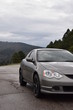 Grey sports car on the road with mountain background