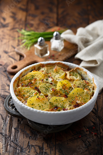 Fotografie, Obraz Homemade potato gratin with bacon and herbs