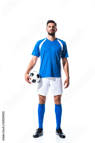 Photo handsome soccer player in uniform with ball Isolated On White