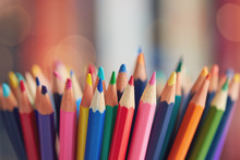 Colorful Colored Pencils On Blurred Bokeh Background