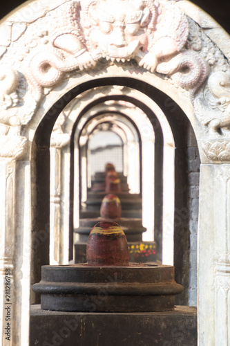 Poster Temple Kathmandu Nepal Pashupatinath Temple is a famous and sacred Hindu temple complex that is located on the banks of the Bagmati River. Beside Pashupatinath temple is open air cremation