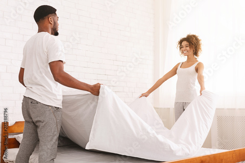 Obraz Charming couple in love making bed together - fototapety do salonu