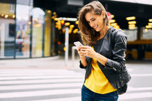Happy Woman Looking At Cell Phone