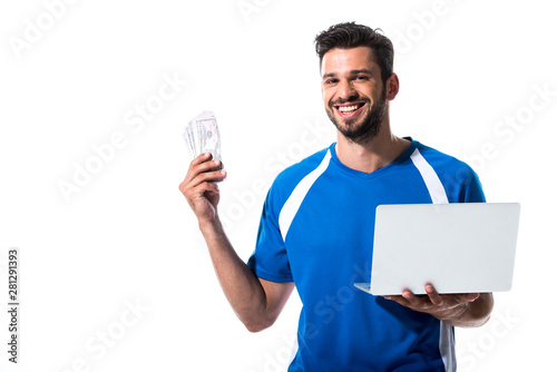 Stampa su Tela happy soccer player with laptop and dollar banknotes Isolated On White
