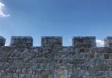 Fortified Castle Wall On Background Blue Sky