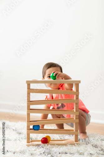 Toddler Girl Playing and Exploring with Montessori Lessons - 281295182