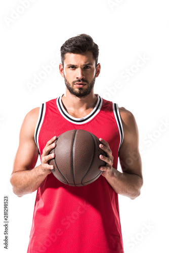 Stampa su Tela sportive basketball player holding ball and looking at camera Isolated On White