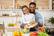 Leinwanddruck Bild - Daddy and daughter making fresh salad in kitchen