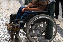 Senior Man Sitting On The Wheelchair Outdoors. Old Beggar Man Asking For Money Donation Help. Social Problems.