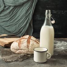 Freshly Baked Rustic Bread Milk In A Bottle On A Dark Concrete B